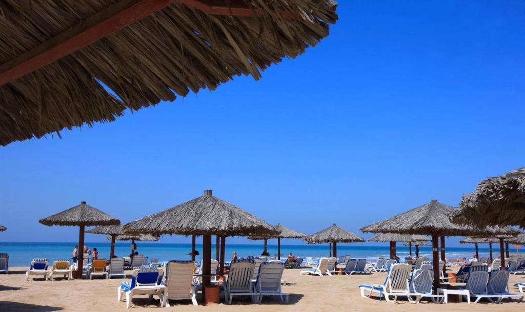 Отель Hilton Al Hamra Beach and Golf Resort, Рас-эль-Хайма, ОАЭ.